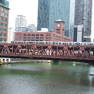 A CTA train crosses a green Chicago River