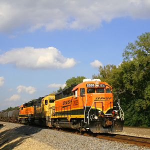 BNSF new logoed GP38-2 2035 through the countryside