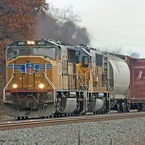 UP #4010 SD70M mixed freight heading west Ogden Dunes, IN