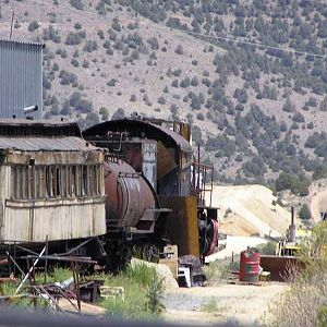 Rusting locomotive, passenger car and caboose