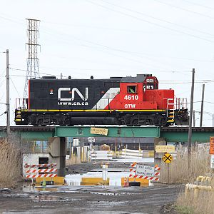 CN light power GP9R on X - E.J. & E line @ Pine Jct