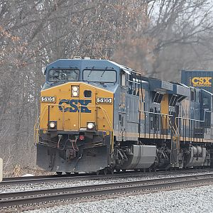 CSX 5105 stack train heads east Co Rd. 150 Portage IN.