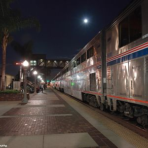 Station Stop Under an Autumn Moon for the Eastbound Southwest Chief at Full