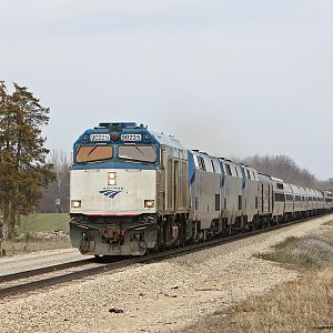 Capital Limited and Lake Shore Limited with Amtrak NPCU 90225 on point pass